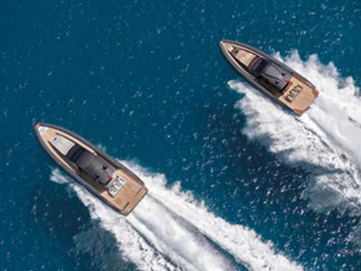 Aerial view of two speedboats carving up the water