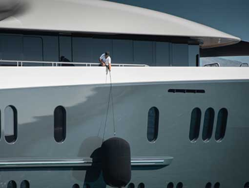 Guy pulling up a Yacht fender