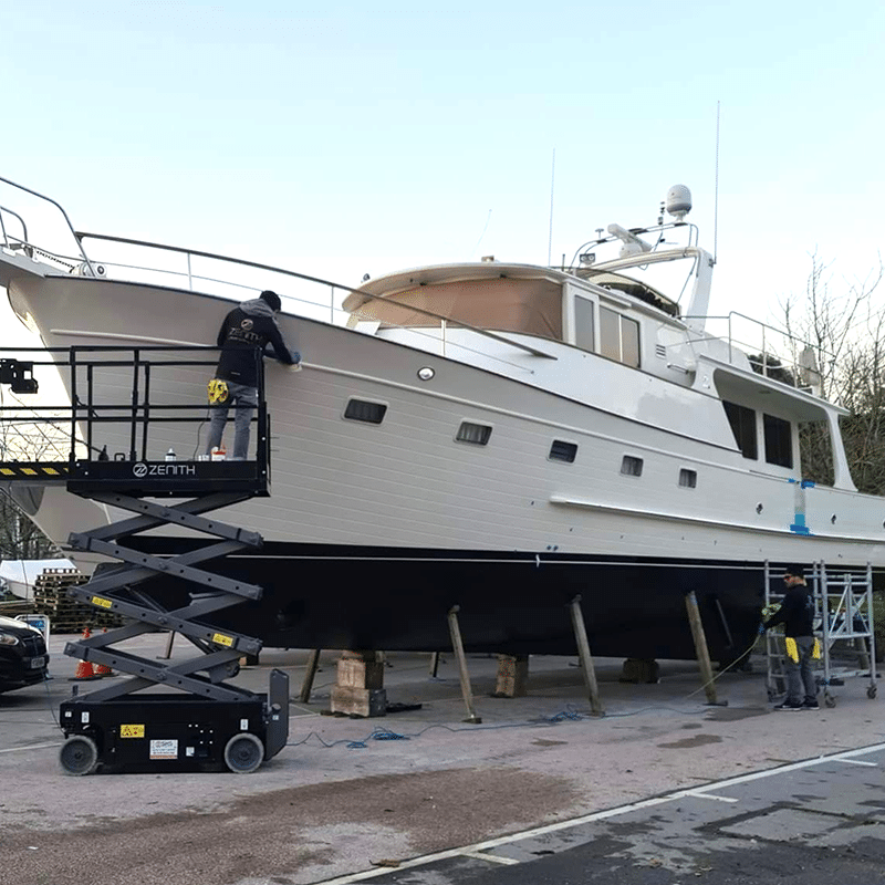 A yacht having work done in yacht surrounded by scaffolding