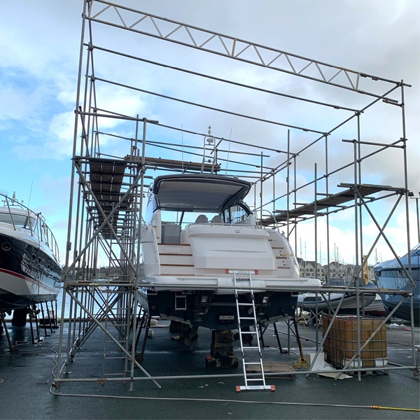 Yacht being worked on by engineer
